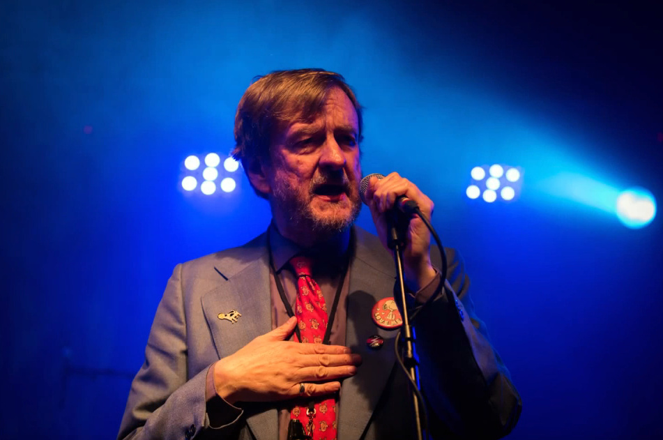 Duglas T Stewart of BMX Bandits singing on stage