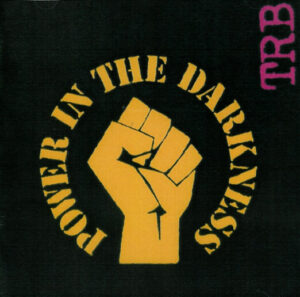 TRB_-_Power_in_the_Darkness_Front_Cover