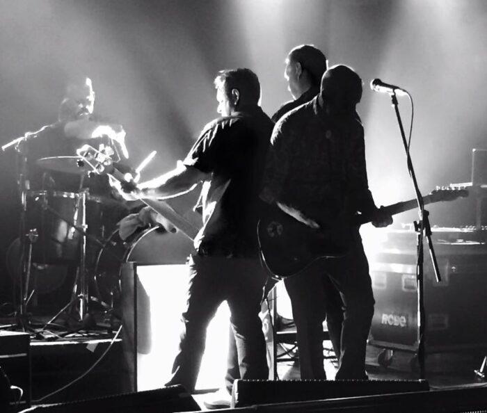 ARCHIVE45 blackandwhite onstage shot