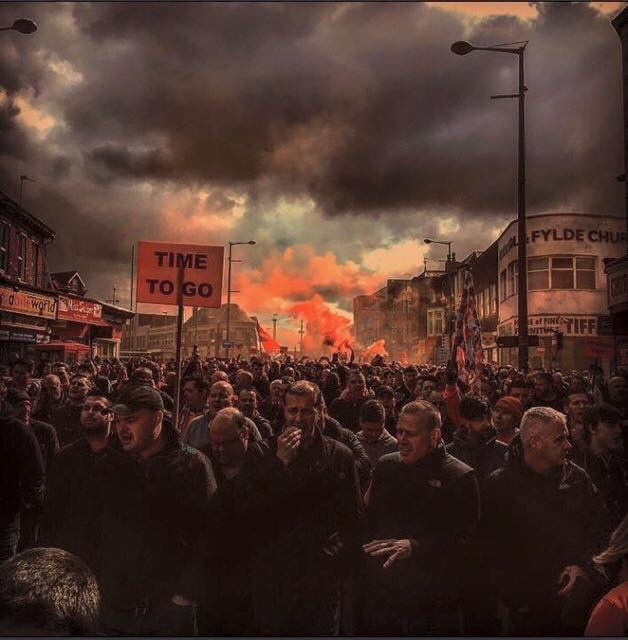 Sport photo of the year? Brilliant photo sums up brooding atmosphere of huge anti Oyston march in Blackpool yesterday