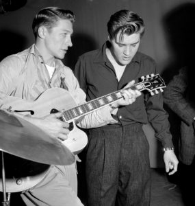LOS ANGELES - JUNE 4:  Elvis Presley and Scotty Moore rehearse for their appearance on the Milton Berle Show at the NBC Burbank studios on June 4 1956 in Los Angeles California. (Photo by Michael Ochs Archives/Getty Images)