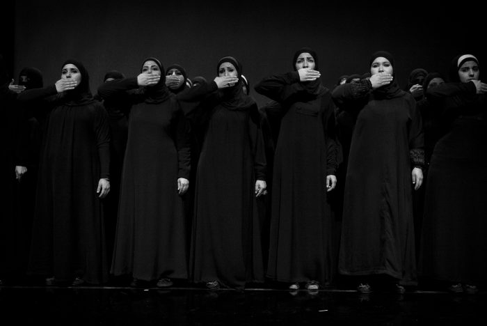 """Syrian women refugees perform in the play """"The Trojan women"""", on december 18th 2013 on the stage of a theather of Amman."""