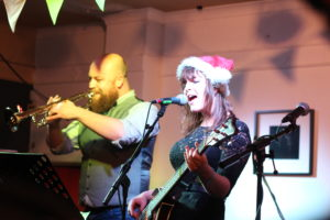 21yr old Emme Woods delights the crowds with a cover of The Doors, entitled 'Riders On The Sleigh'