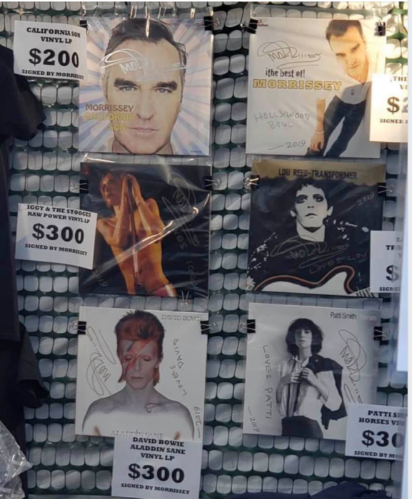 Weird merch : Morrissey selling classic albums by other people that he has autographed on his merch stall