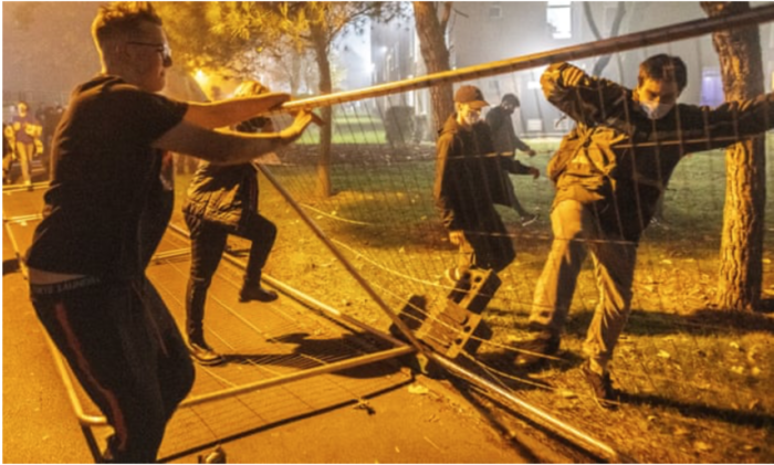 Manchester students tear down fences erected around campus