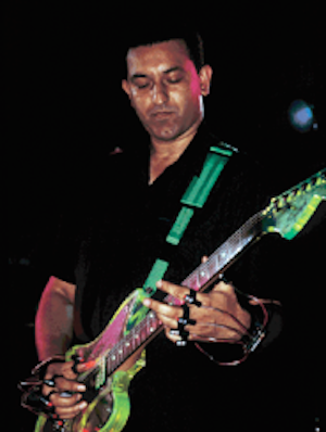 Louder Than War talk to Aziz Ibrahim, guitarist with Simply Red and Stone Roses, on the eve of his 50th birthday event